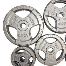 Grey Tri-Grip Olympic Weight Plates.