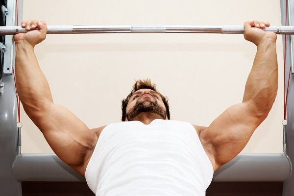 man performing bench press exercise
