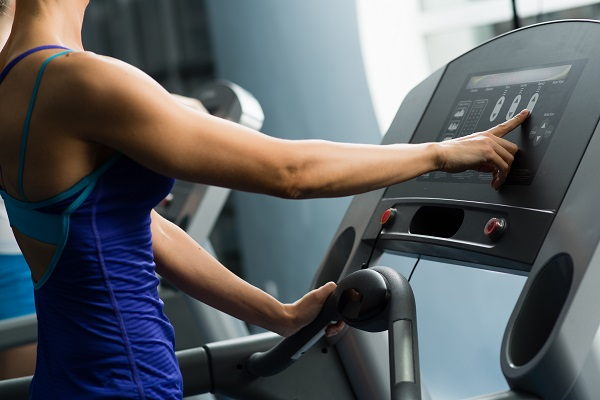 Woman checking treadmill