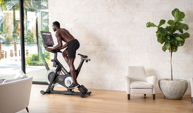 How to get the most out of your exercise bike: 4 Top Tips from a PT